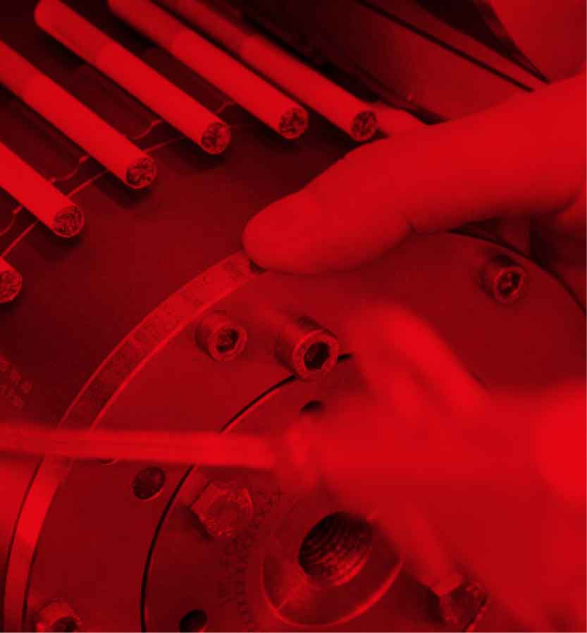 A mechanical drum with cigarettes on a red background symbolising the filter combiner category.